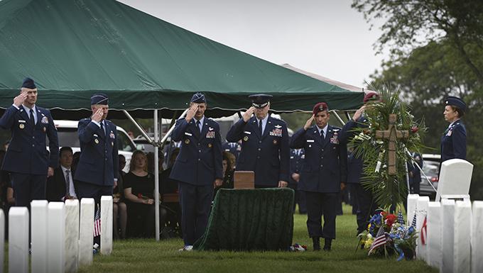 DANG, CCM, ANGRC commander salutes the urn of Maj. Andreas O'Keefe.